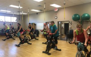 spin class students working out