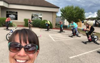 spin class with instructor smiling
